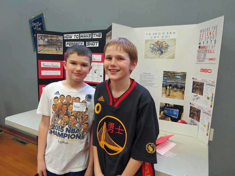 SUBMITTED PHOTO: PJ CLARK - Fourth-graders Peter Cory (left) and Adam Wrenn's project, 'The Science of Steph Curry's Shot,' was a crowd favorite at the Science Fair last week.