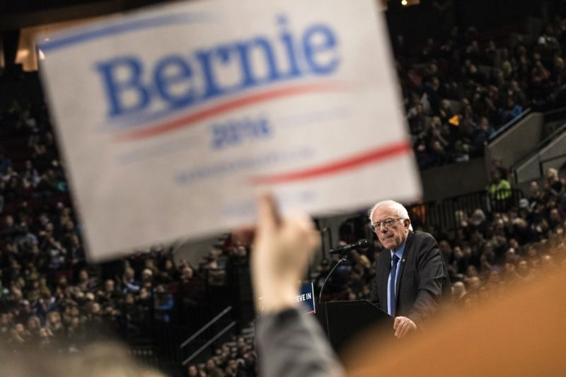 TRIBUNE PHOTO: JONATHAN HOUSE - Supporters of U.S. Sen. Bernie Sanders packed the Moda Center Friday morning, cheering the Democratic presidential candidate.