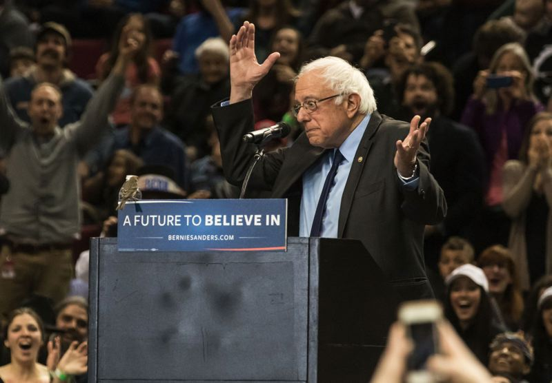TRIBUNE PHOTO: JONATHAN HOUSE - Sen. Bernie Sanders reacted to a small bird that landed on his podium during his speech at the Moda Center Friday morning.