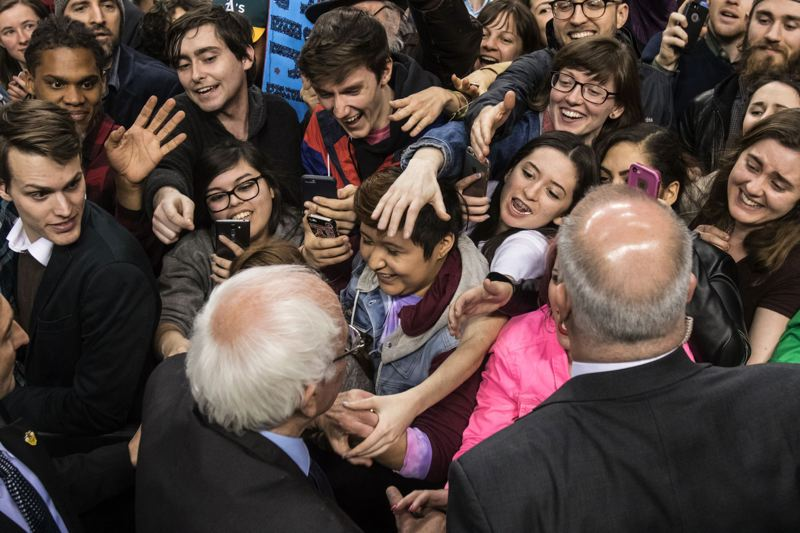 TRIBUNE PHOTO: JONATHAN HOUSE - Supporters clamor to shake hands with U.S. Sen. Bernie Sanders after his speech at the Moda Center Friday morning.