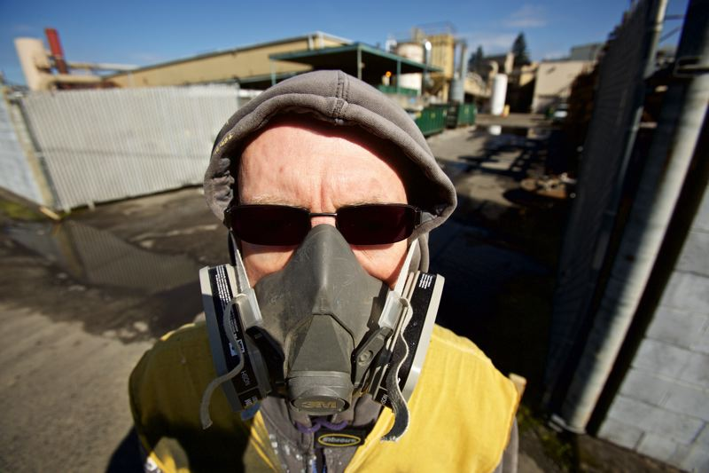 TRIBUNE PHOTO: JAIME VALDEZ - Albert Zayha, an activist in South Portland Air Quality, often wears his gas mask at protests against toxic air releases.