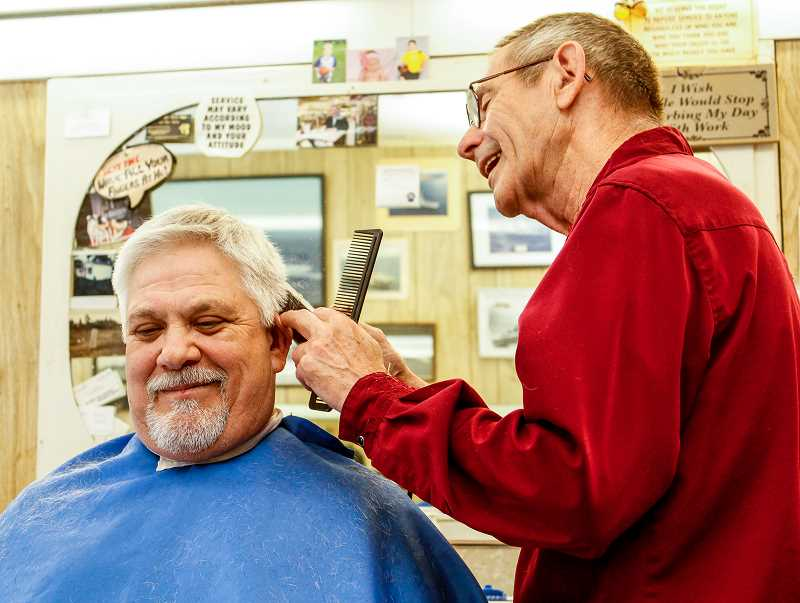 HILLSBORO TRIBUNE PHOTO: TRAVIS LOOSE - Bruce Reedy, owner of Bruces Barber Shop in downtown Hillsboro, has been cutting Hillsboro resident Richard Gaumones hair (left)  off and on since 1997. 'By far, Bruce have given me the best haircuts I;ve ever gotten,' Gaumone said.