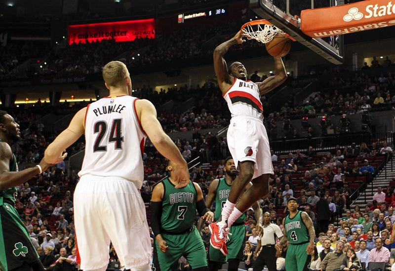 TRIBUNE PHOTO: DAVID BLAIR - Al-Farouq Aminu of the Trail Blazers dunks on Boston.