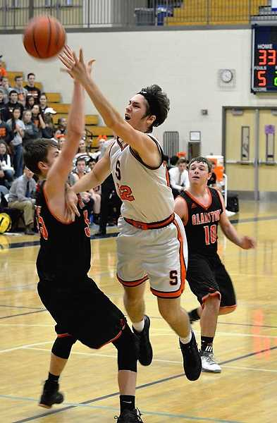 SPOTLIGHT PHOTO: JAKE MCNEAL - Scappoose senior forward Ian Donaldson was named an OSAA Class 4A Boys' Basketball all-state honorable mention on Tuesday.