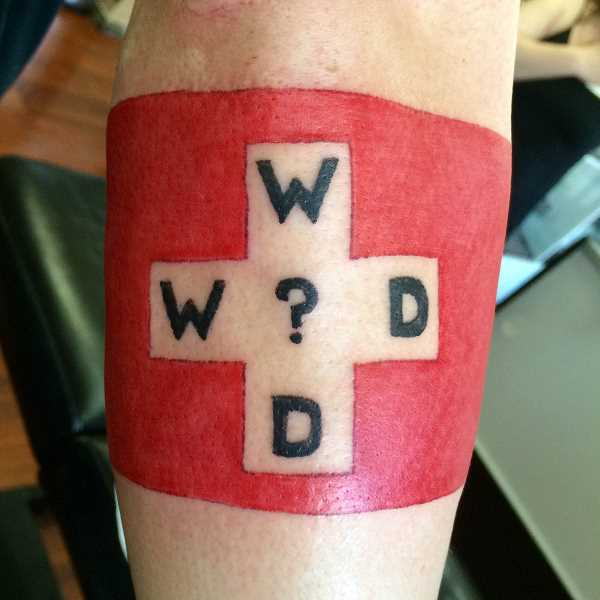 COURTESY PHOTO - Three weeks after his brother-in-law, mentor and friend, Doug Bonham, died in a car accident, News-Times reporter Travis Loose got this What Would Doug Do? tattoo. The Swiss flag design commemorates how Doug tried to provide a neutral, safe haven in family arguments, earning him the nickname Switzerland. Traviss wife and her sister got Doug tattoos the same day.