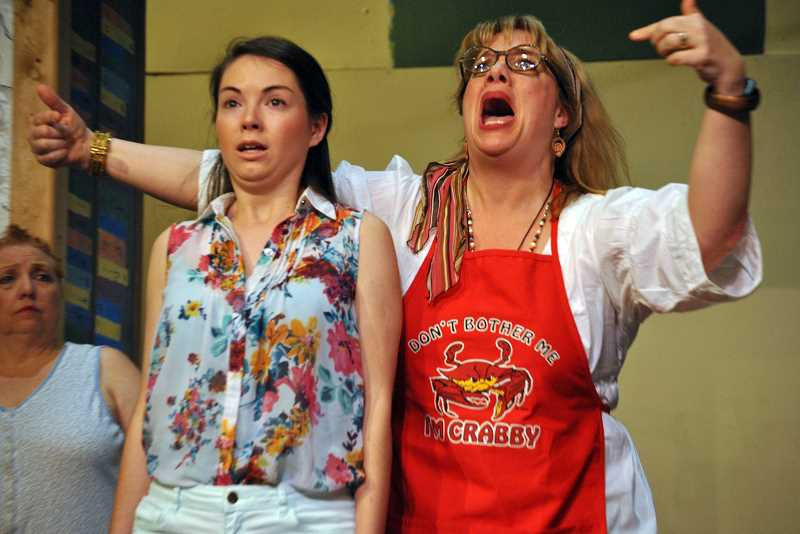 Wendy Bax (right) plays a cleaning woman named Cassandra, who warns of impending doom, while Rachel May plays Nina, an aspiring actress.