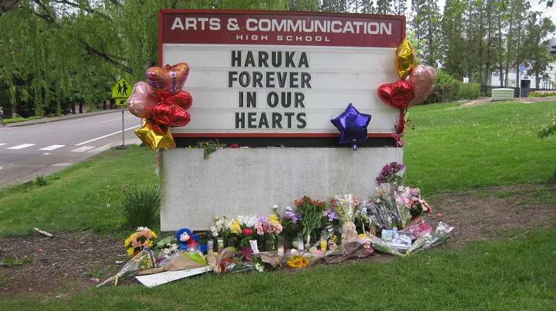 TIMES PHOTO: ERIC APALATEGUI - The reader board at ACMA has turned into a memorial for Haruka Weiser, who was murdered April 3 at the University of Texas, where she had won a full-ride dance scholarship.