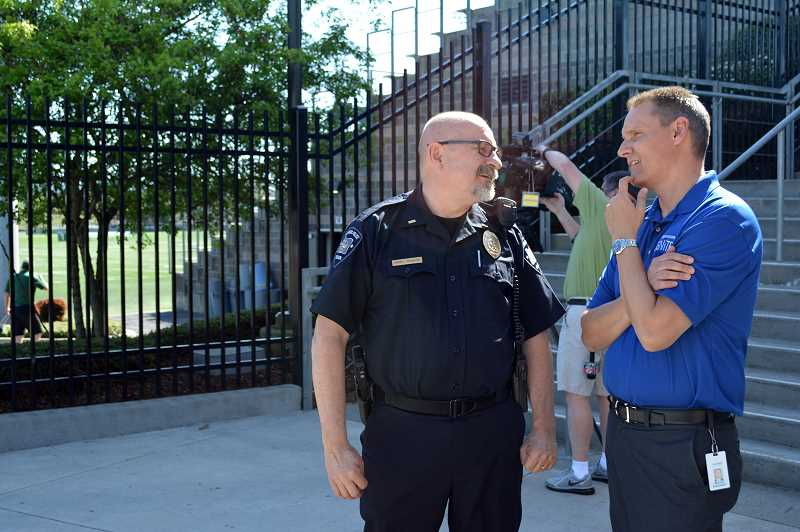 HILLSBORO TRIBUNE PHOTO: KATHY FULLER - Hillsboro Police Department Lt. Henry Reimann chats with Hillsboro School District Superintendent Mike Scott at the district's large-scale parent reunification drill.