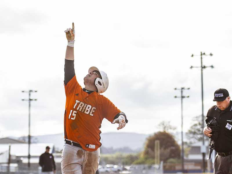 NEWS-TIMES PHOTO: CHASE ALLGOOD - Scappooses' Jhamante' Woods points to the sky after hitting a home run during Banks' 2-1 win over Scappoose Friday.