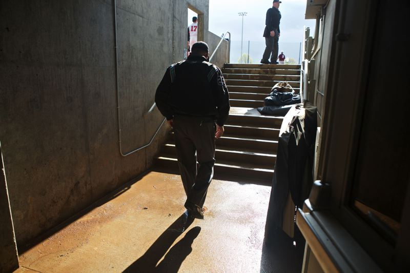 TRIBUNE PHOTOS: JAIME VALDEZ - Steve Bartelstein, once a sports anchor at KGW (8), heads up the stairs to work a Franklin-Lincoln high school baseball game last week at Ron Tonkin Field.