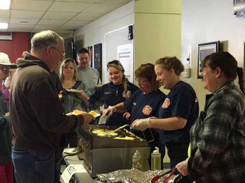 CONTRIBUTED PHOTO: ESTACADA RURAL FIRE DISTRICT - Community members gathered Saturday at the Estacada Fire Station to have breakfast and support the Sanchez-Serrano family.