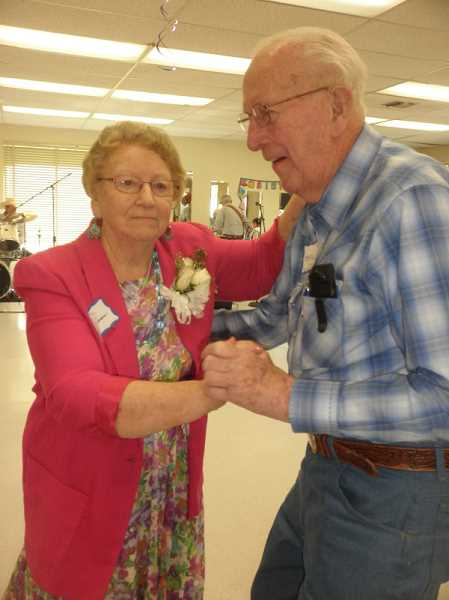CONTRIBUTED PHOTO - Harold Thurber and Violet Sullivan dance the afternoon away at Harold's 100th birthday party held on Saturday at the Estacada Community Center. The couple has been a couple for 22 years.