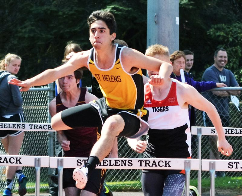 SPOTLIGHT FILE PHOTO: JAKE MCNEAL - Lions sophomore Daniel Lujano won the 110-meter hurdles in 16.38 seconds and the triple jump in 42 feet, 8 inches on Wednesday at Hillsboro High School.