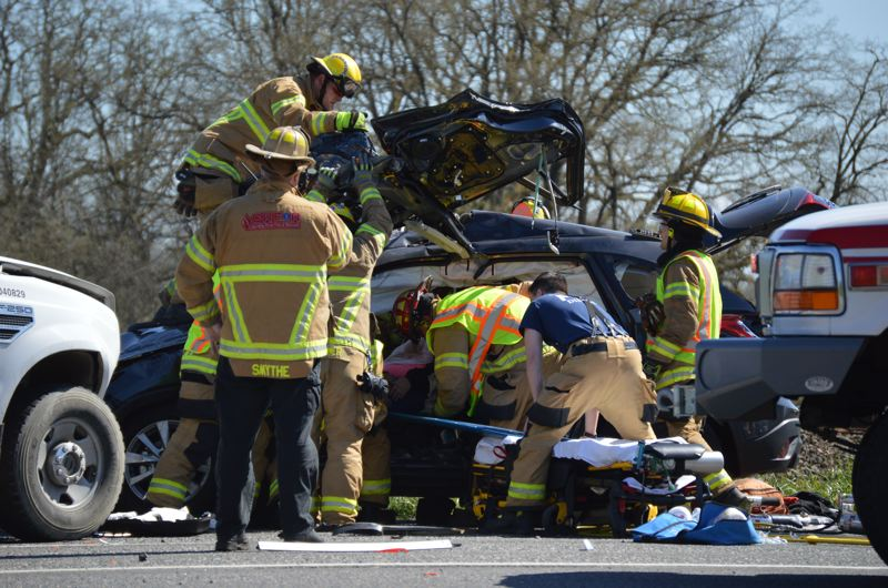 SPOTLIGHT PHOTO: COURTNEY VAUGHN - Columbia River Fire and Rescue and Scappoose Fire District crews respond to a car crash on Highway 30 in March. The two fire districts often assist each other on major calls for fires and car crashes.