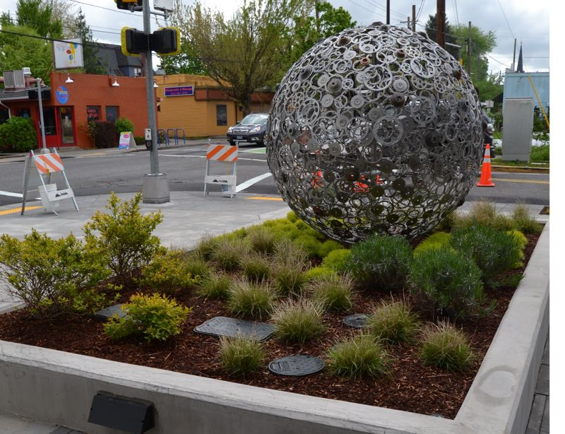 JULES ROGERS - The sculpted orb, made from bicycle gears, represents the cycle-centric buildings amenities and location.