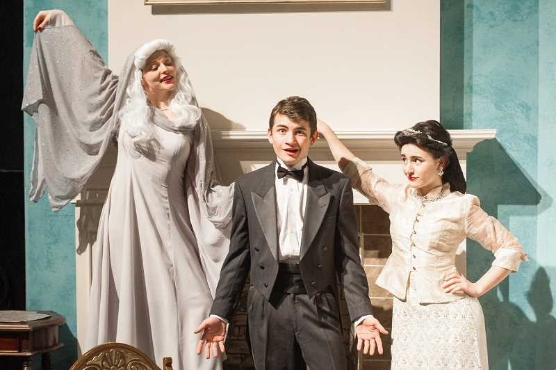 OUTLOOK PHOTO: JOSH KULLA - From left, Marlo Phillips plays the ghost of Elvira Condomine, Connor Hughes plays Charles Condomine, and Riley Olson plays Ruth Condomine in Gresham High School's production of 'Blithe Spirit,' the famous Noel Coward comedy.