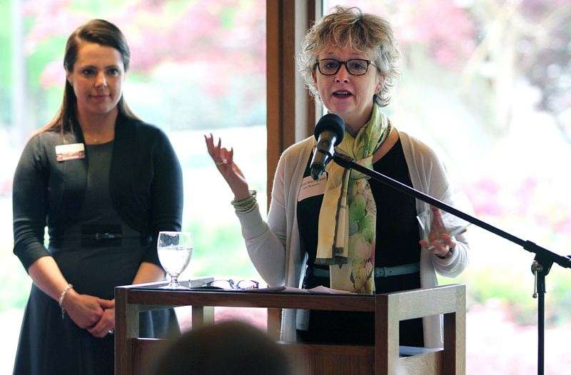 TIMES PHOTO: MILES VANCE - Lam Research's Denise Macrigeanis reacts after Lam was presented with the Tualatin Chamber of Commerce award for Outstanding Business Large during Thursday's Celebrate Tualatin event at Tualatin Country Club.