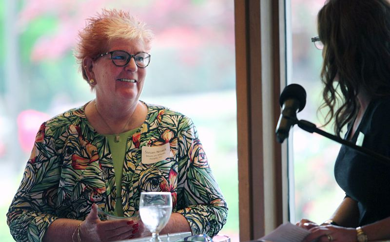 TIMES PHOTO: MILES VANCE - Susan Noack of Meals on Wheels People smiles as Sherilyn Lombos of the city of Tualatin presents her with the Tualatin Chamber of Commerce award for Spirit of Tualatin during Thursday's Celebrate Tualatin event at Tualatin Country Club.