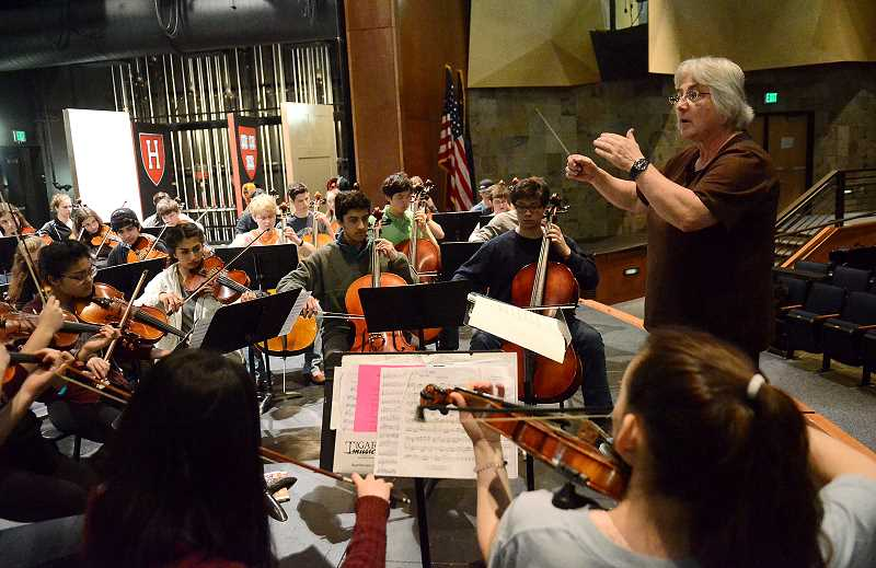 REVIEW PHOTO: VERN UYETAKE - Nita Van Pelt directs the Lakeridge High School orchestra during a practice on April 13. Already a recipient of the Oberlin Conservatory's Distinguished Music Education Alumna Award, Van Pelt received the Portland Youth Philharmonics Mary V. Dodge Award on Monday.
