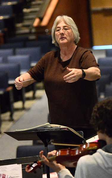REVIEW PHOTO: VERN UYETAKE - Nita Van Pelt has been an orchestra conductor in the Lake Oswego School District since 1986.