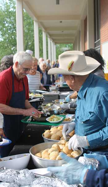 Volunteers spend hours grilling steaks to satisfy the crowd at the annual Steak Feed.