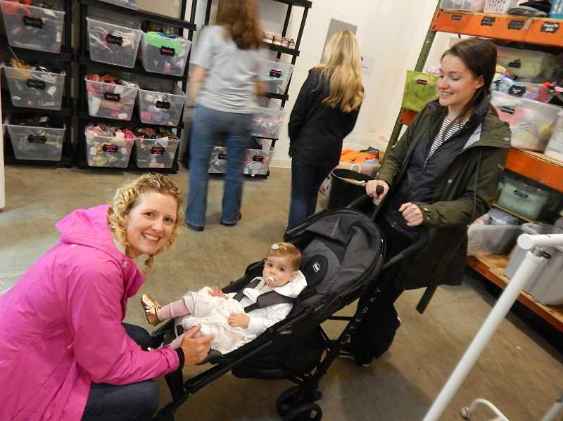 REVIEW PHOTO: CLIFF NEWELL - Rebecca Kelso greets Christina Nunez and her beautiful baby Selah at the With Love open house on April 14. Kelso has made a huge contribution to the organizations growth.