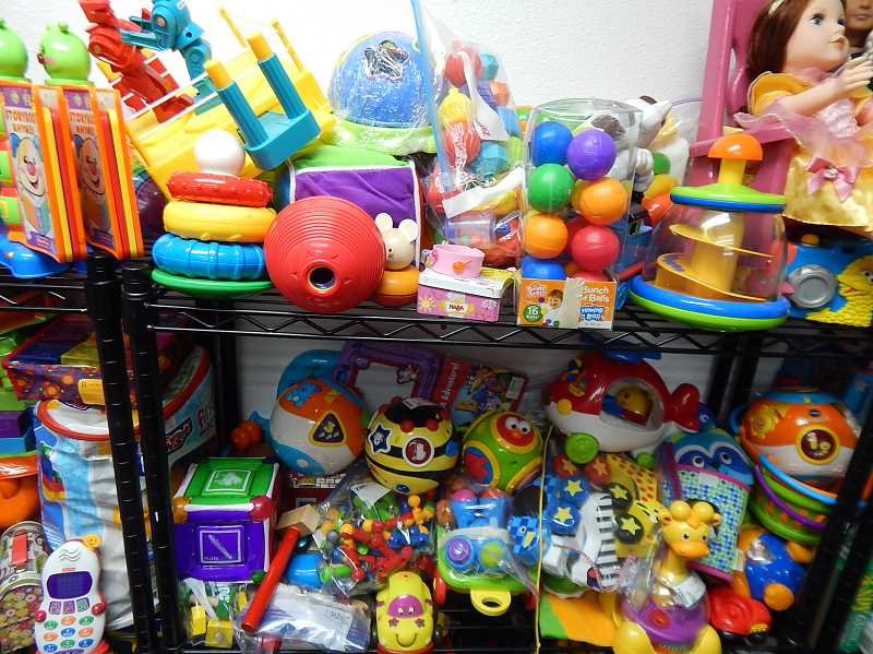 REVIEW PHOTO: CLIFF NEWELL - Shelves full of toys are available at the With Love warehouse in Tigard. The organizations gets lots of donations, including some big surprises.