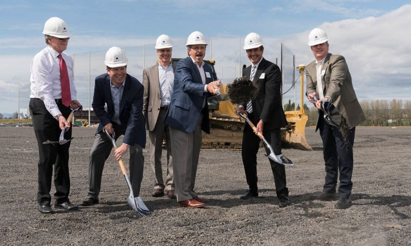 SUBMITTED: COLLIERS INTERNATIONAL - Leaders celebrate at an April groundbreaking of a 303,360 square foot facility, which has an expected completion date of  (left to right) John S. Perkins, Executive Vice President, Commerce Construction Co. (part of Majestic Realty) Mark McClung, Vice President, Colliers International Mike Thomas, Senior Vice President, Colliers International Mayor Jerry Willey, City of Hillsboro Phillip Brown, Executive Vice President, Majestic Realty Co. Marc Burns, Vice President, Majestic Realty Co.