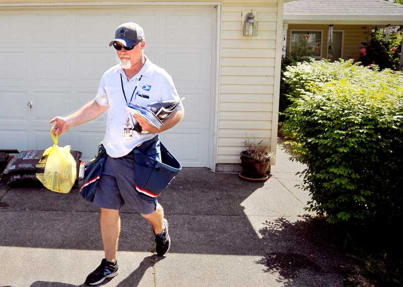 GARY ALLEN FILE PHOTO - More than two dozen mail carriers will gather food donations Saturday and deliver them to Newberg FISH and Dundee Promise Pantry.