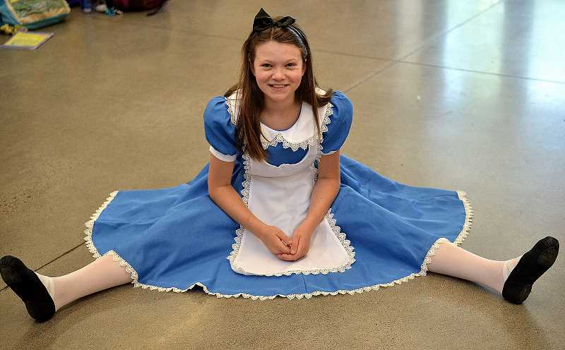REVIEW PHOTO: VERN UYETAKE - Riverdale Grade School students this week are putting on 'Alice in Wonderland Jr.,' a simplified version of Lewis Carroll's classic tale of a girl who went down the rabbit hole. Fifth-grader Emilie Cocke plays Alice.