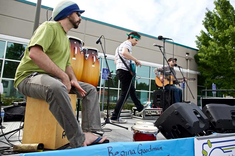 TIMES PHOTO: JAIME VALDEZ - The band Cilantro entertains market-goers. Eric Johnston is on percussion, Dusty Richards on bass and Brendan Diezon on guitar.