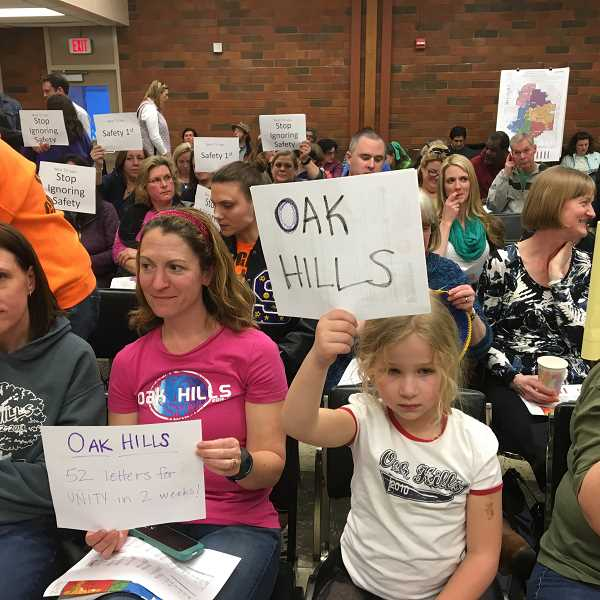 TIMES PHOTO: ERIC APALATEGUI - Abby McLaughlin, 6, held up a sign in March to try to sway a committee's decision on high school boundaries. The Beaverton School Board could sign off on the process as early as Monday.