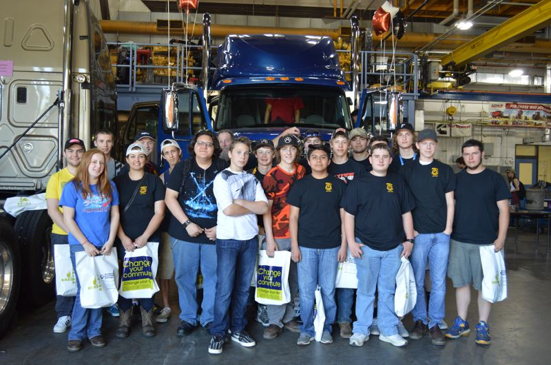 SPOTLIGHT PHOTO: NICOLE THILL - Students involved in the St. Helens High School automotive and mechanic program pose in front of a diesel engine during Diesel Day.