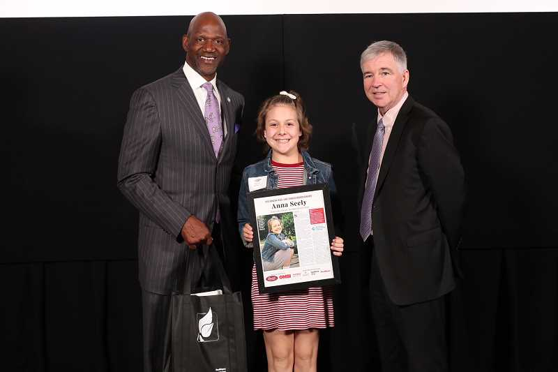 PAMPLIN MEDIA GROUP PHOTO: JAIME VALDEZ - Anna Seely, Lake Oswego's 'Amazing Kid,' poses with former Portland Trail Blazer Terry Porter and Pamplin Media Group President Mark Garber at a special event Monday in Portland.