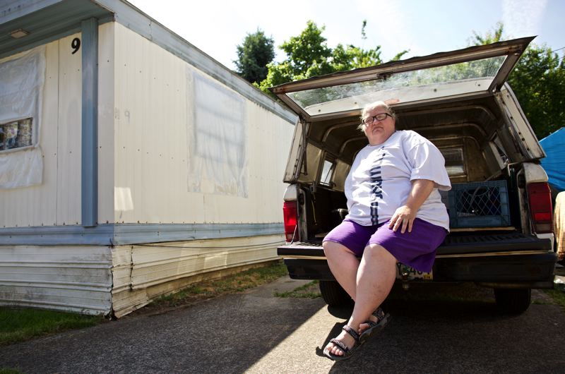TRIBUNE PHOTO: JAIME VALDEZ - Renae Corbett, a resident of Oak Leaf mobile home park, hopes she doesnt have to sleep in the back of her pickup truck again. Corbett is one of 65 residents faced with having to move, due to a pending sale of the mobile home park in the Cully neighborhood.