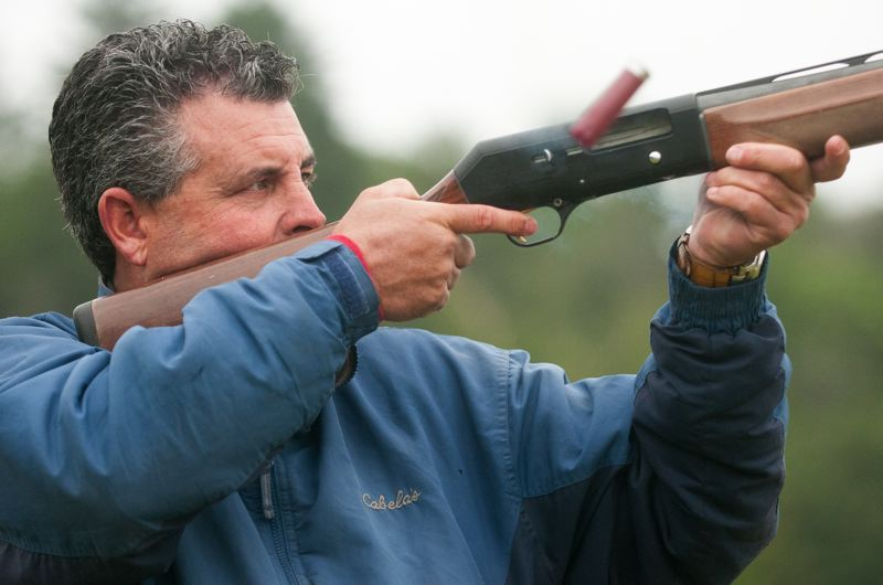POST PHOTO: JOSH KULLA - Gold Rush cast member Andy Spinks fires at a trap target Saturday at the Portland Gun Club during a fundraiser for Sandy Young Life.