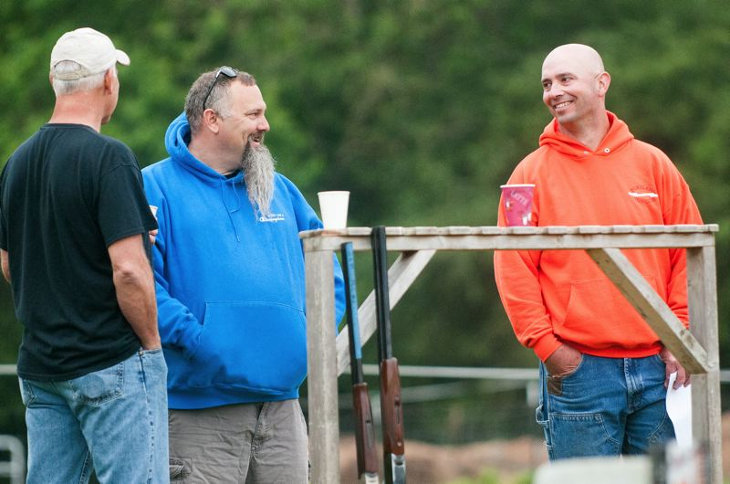 POST PHOTO: JOSH KULLA - Todd Hoffman, star of Gold Rush and a Sandy resident (middle), chats with participants during Saturdays Young Life fundraiser at the Portland Gun Club.