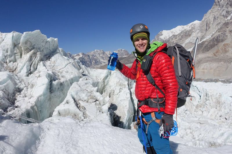COURTESY: COLIN O'BRADY - Colin O'Brady stands on Mount Everest, which he summited Wednesday evening, Portland time.