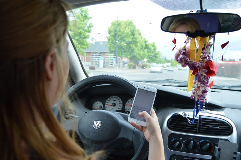 SPOTLIGHT PHOTO ILLUSTRATION - Using a cell phone while driving is a primary example of distracted driving, but is one of many risky behaviors drivers can exhibit. Law enforcement said citing people for cell phone use is not a top priority in the county.