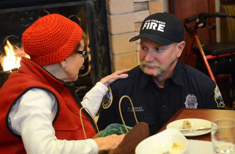REVIEW PHOTO: VERN UYETAKE - LOFD Driver Engineer Brad Hensley enjoys a chat with resident Louise Eddy during breakfast at The Stafford.