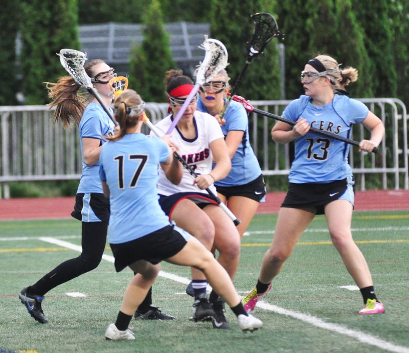 MATTHEW SHERMAN - Lake Oswego's Carlie Leach is surrounded by a quartet of Lakeridge defenders during last week's playoff victory against the Pacers.