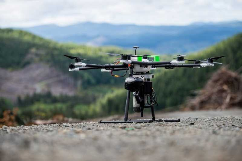 COURTESY DRONESEED - Drones combined with sophisticated software can be programmed to precisely spread tree seeds or herbicides used in reforestation projects.