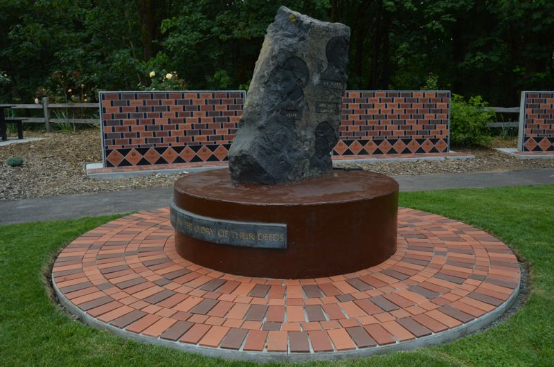 SPOTLIGHT PHOTO: NICOLE THILL - A sculpture dedicated to all servicemen and women in the park is designed to have a sunbeam shine through it at noon on a certain date around Memorial Day. Behind the plaque are several walls inscribed with the names of veterans on individual bricks.