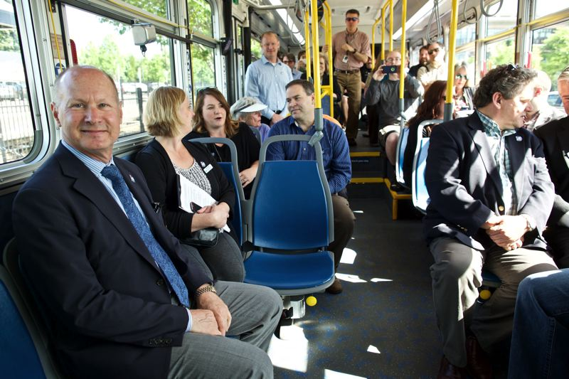 TIMES PHOTO: JAIME VALDEZ - Neil McFarlane, TriMet general manager, sits with local dignitaries on TriMet bus line 97 before the bus' departure from the Tualatin WES station to Sherwood.