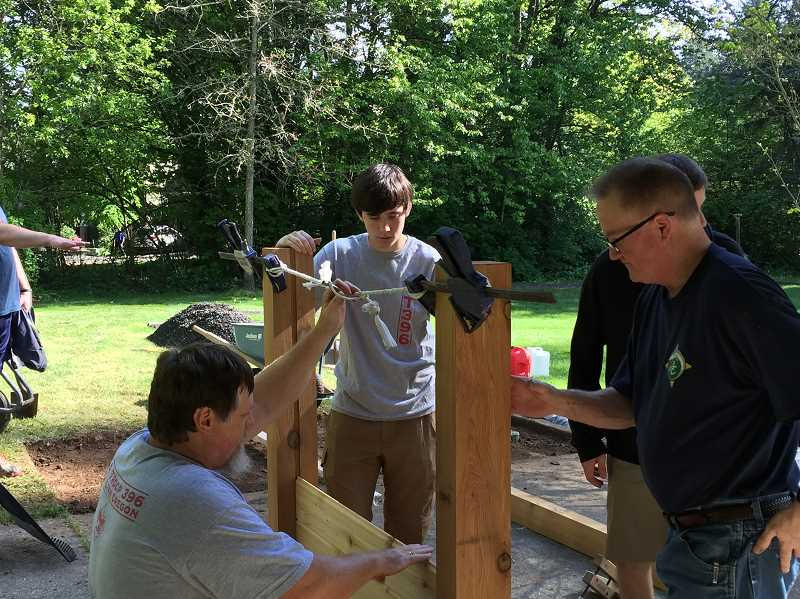 SUBMITTED PHOTO - Connor Currey, middle, works on his Eagle Scout project - an informational kiosk near the Willamette boat dock in West Linn.