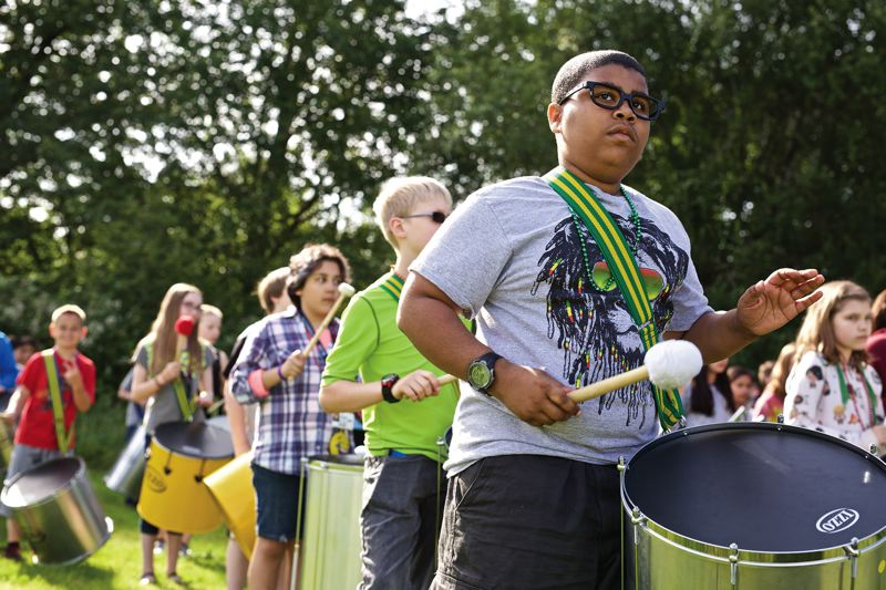 TIMES PHOTO: JAIME VALDEZ - Fifth-grader Taylor Jhaywon plays the surdo drum with his classmates at Durham Elementary School as they prepare for their samba performance in the Rose Parade.