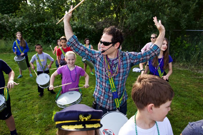 TIMES PHOTO: JAIME VALDEZ - Marc Silverman, a music teacher at Durham Elementary, helps fifth-graders prepare for their samba performance in the Rose Parade.