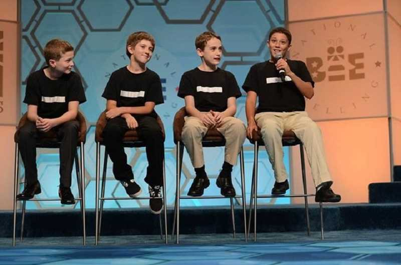 MARK BOWEN/SCRIPPS NATIONAL SPELLING BEE - River Grove finalists (from left) Colby Ackerman, Wes Holland, Henry Sturges and Nick Wittig beam onstage as they await results in the Scripps National Spelling Bee's inaugural Spellebrity Video Contest in Washington, D.C.