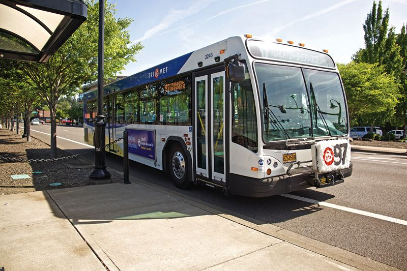 TIMES FILE PHOTO: JAIME VALDEZ - A bus on line 97 idles on Southwest Boones Ferry Road at the Tualatin WES station last Tuesday during a 'first ride' event for the new service.