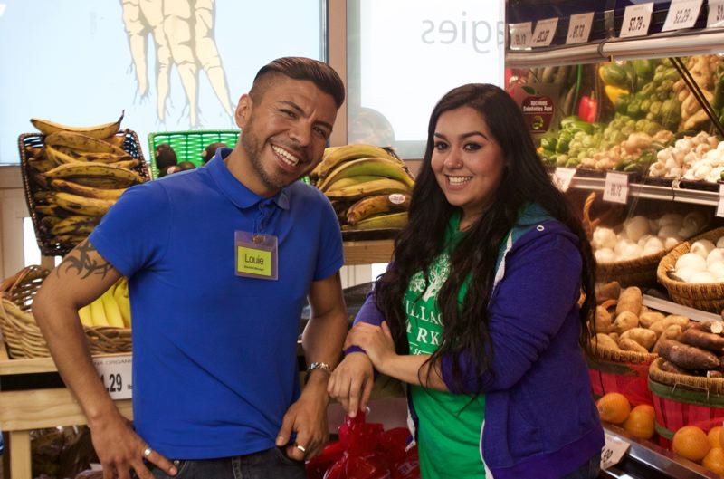 PORTLAND TRIBUNE: CHRISTOPHER KEIZUR - Louie Rico, left, and Yadira Bracamontes live in New Columbia and help provide healthy food to their neighbors by working at the Village Market.